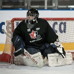 team canada blind hockey goalie in sport mask with otny cage
